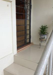 Panel on door gate to keep cats indoors
